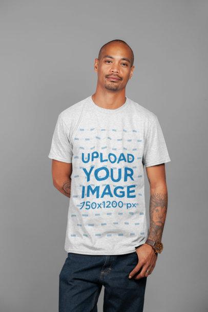 T-Shirt Mockup of a Tattooed Man at a Studio 23944