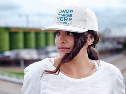 Hat Mockup of a Woman Standing on a Balcony a7658