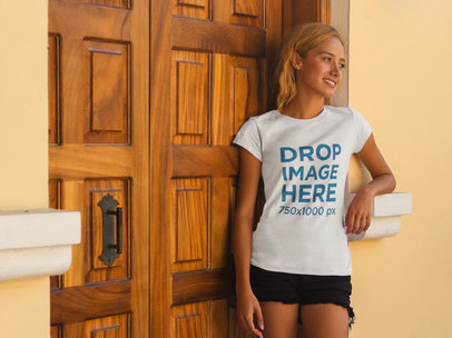Woman Leaning Against a Door Frame T-Shirt Mockup a7816