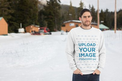 Crewneck Sweatshirt Mockup of a Bearded Man Standing in a Snowy Landscape 25098