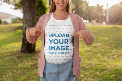 Mockup of a Happy Pregnant Woman Pointing at Her T-Shirt 26671