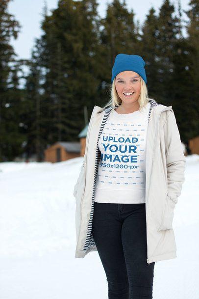Sweatshirt Mockup of a Woman Wearing Casual Winter Attire in the Snow 25083