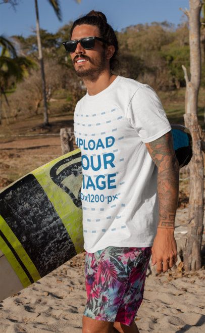 T-Shirt Mockup of a Tattooed Surfer Man at the Beach 26766