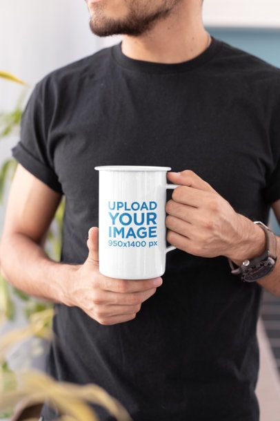 Mockup of a Young Man Holding a 21 Oz Enamel Mug  26932