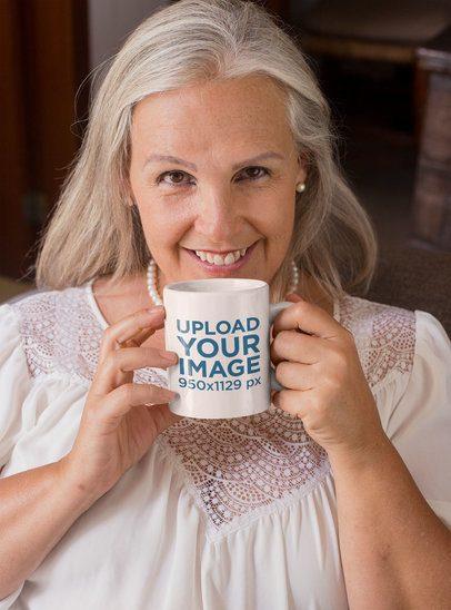 11 Oz Coffee Mug Mockup Featuring a Smiling Senior Woman 27450