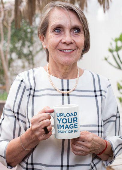Mockup of a Senior Smiling and Holding Her 11 Oz Mug 27447