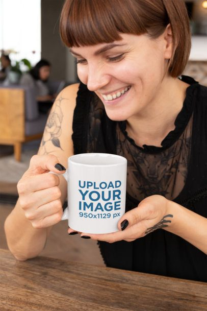Mockup of a Smiling Tattooed Woman Holding an 11oz Coffee Mug 27233