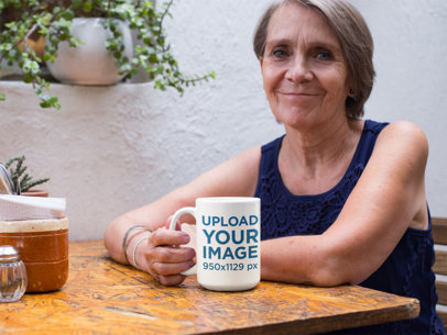 15 Oz Coffee Mug Mockup of a Kind Elderly Woman Sitting at a Table 27439