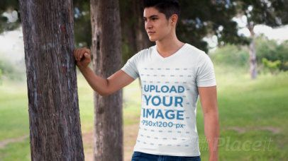 Parallax Video of a Young Man Wearing a Camping T-Shirt Outdoors 27667