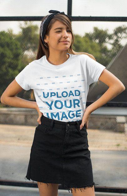 T-Shirt Mockup of a Woman with a Headband Winking at the Camera 27332