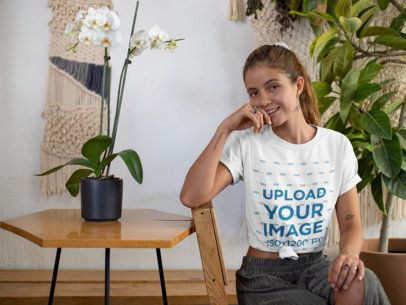 Mockup of a Woman with a Knotted T-Shirt in a Rustic Living Room 27089