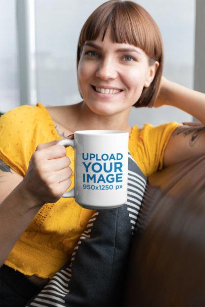 Mockup of a Woman with Bangs Holding a 15 Oz Coffee Mug 27249