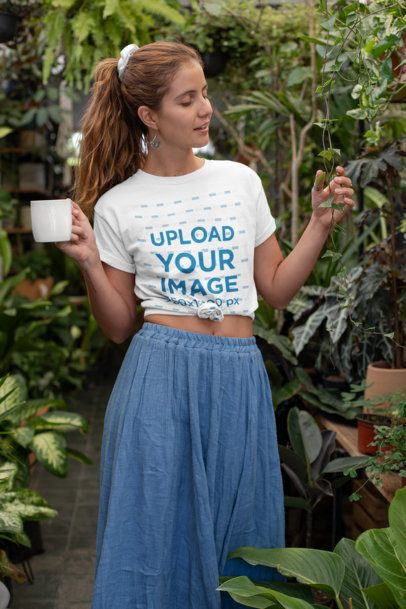 Mockup of a Hippie Woman with a Knotted T-Shirt at a Greenhouse 27085