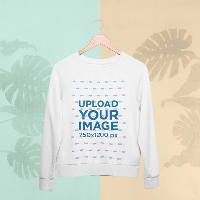 Crewneck Sweatshirt Mockup Hanging Against a Colored Background with Plants Silhouettes 27018
