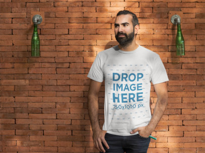 Man Standing in Front of a Brick Wall T-Shirt Mockup a8236