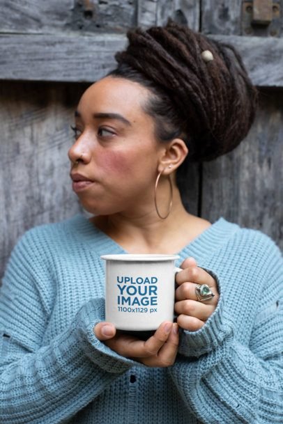 Mockup of a Woman with Beehive Hairstyle Holding a 12 Oz Enamel Mug 26970