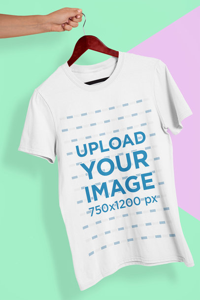 Mockup of a Hand Holding a T-Shirt in a Colorful Background 26735