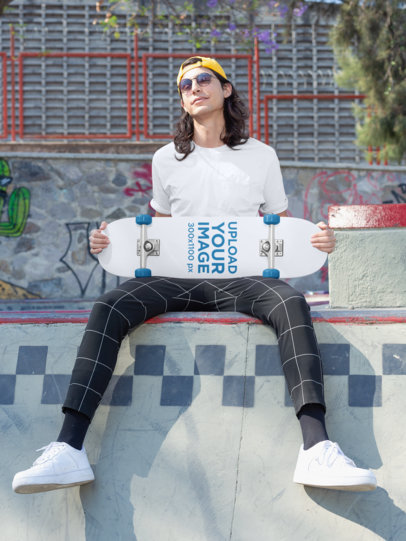 Skateboard Mockup Featuring a Young Man Sitting on Top of a Skate Ramp 27195