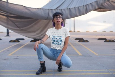 T-Shirt Mockup of an Edgy Woman at a Parking Lot 27067