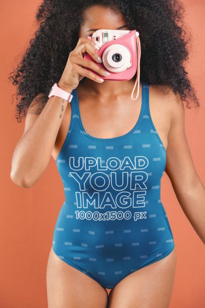 Swimsuit Mockup of a Woman Taking a Photo with a Retro Polaroid Camera 26570