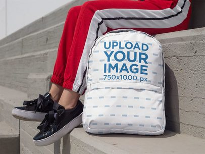 Backpack Mockup Featuring a Woman Sitting on Concrete Bleachers 27713