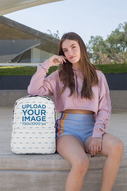 Backpack Mockup Featuring a Teenager Sitting on Concrete Floor 27715