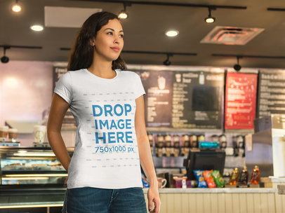T-Shirt Mockup of a Beautiful Girl at a Coffee Shop a8405