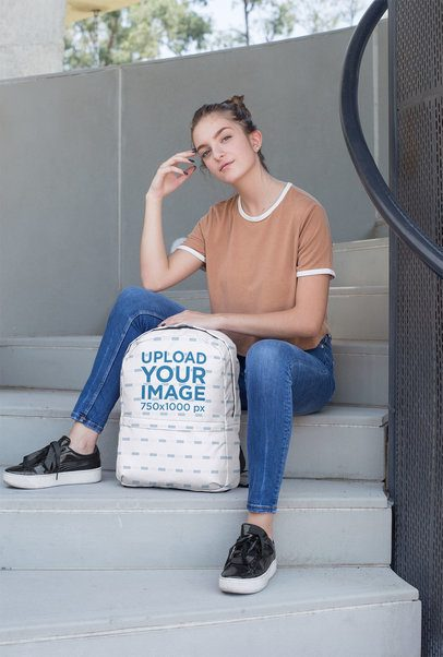 Backpack Mockup Featuring a Female Teenager Sitting on a Stairway 27721