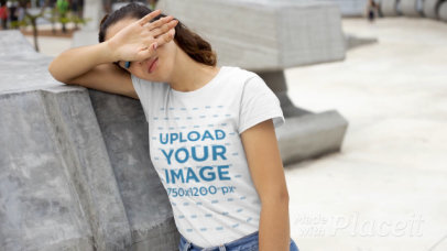 T-Shirt Video Featuring a Woman Leaning on a Concrete Structure 22720