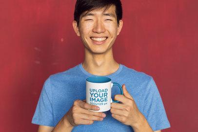 11 oz Two-Toned Mug Mockup Featuring a Joyful Man against a Red Background 27825