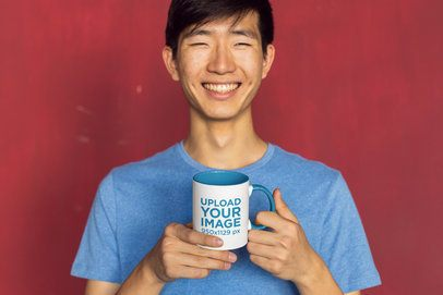 11 oz Two-Toned Mug Mockup Featuring a Joyful Man against a Red Background 27825