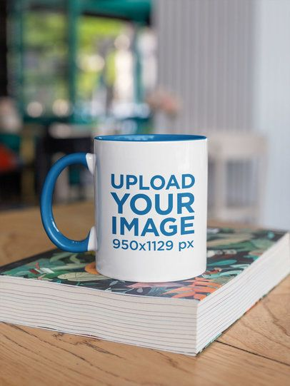 Mockup of a Two-Toned 11 oz Coffee Mug Mockup on a Table 27837