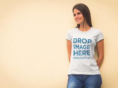Beautiful Woman Leaning Against a Wall T-Shirt Mockup a8303
