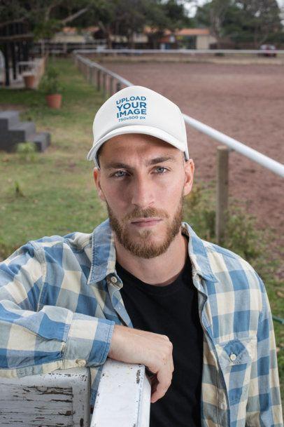 Trucker Hat Mockup of a Bearded Ranch Worker 27963