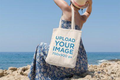 Tote Bag Mockup Featuring a Woman Facing Backward at the Beach 15-el