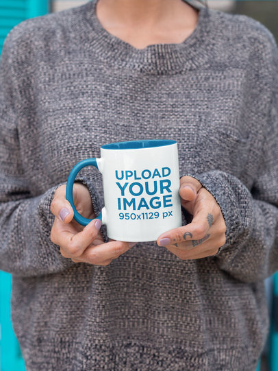 Mockup of a Woman with a Cozy Look Holding an 11 oz Color Rim Mug 27843