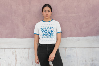 Mockup of a Woman with a Ringer Tee Leaning Against a Paint-Dripping Wall 27166