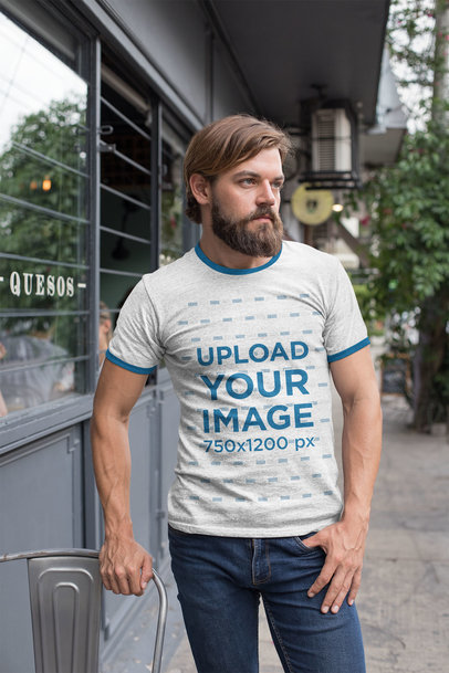 Ringer T-Shirt Mockup Featuring a Bearded Man Outside a Restaurant 27915