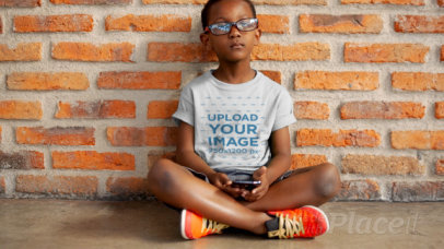 T-Shirt Video of a Little Boy Playing with a Phone 12589