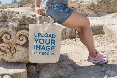 Tote Bag Mockup Featuring a Woman in a Rocky Scenery 16-el