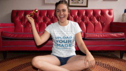 T-Shirt Video Featuring a Joyful Woman Sitting on a Carpet 22436