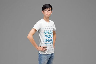 T-Shirt Mockup Featuring a Man Proudly Posing Against a Plain Background 27873