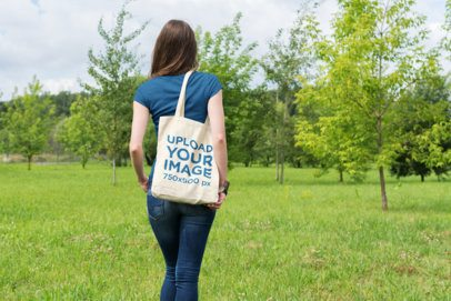 Mockup of a Woman Walking Towards a Grove While Carrying a Tote Bag 21-el