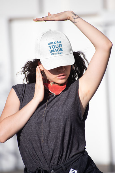 Mockup of a Woman with a Dad Hat Posing in The Street 27032