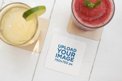 Square Coaster Mockup Featuring Two Drinks on a White Wooden Table 27799