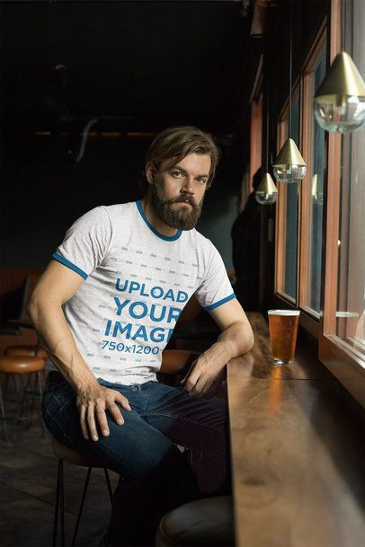 Heather Ringer Tee Mockup of a Man Drinking a Beer in a Bar 27930