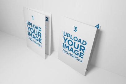 Mockup of Two Folded A5 Brochures Standing Next to Each Other Against a Flat Surface 32-el