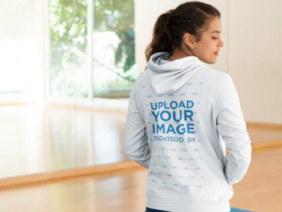 Back Shot of a Woman in a Hoodie at a Yoga Class a8617