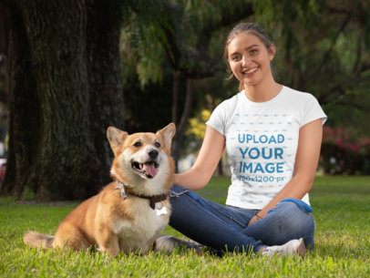 T-Shirt Mockup of a Woman with Her Corgi at a Park 28037