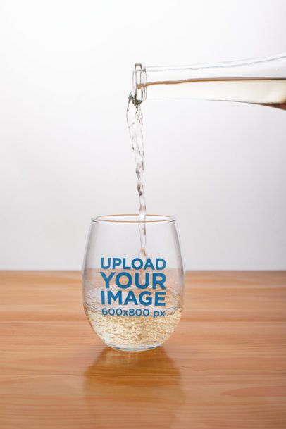 Mockup of Liquor Being Poured into a Stemless Wine Glass 27936